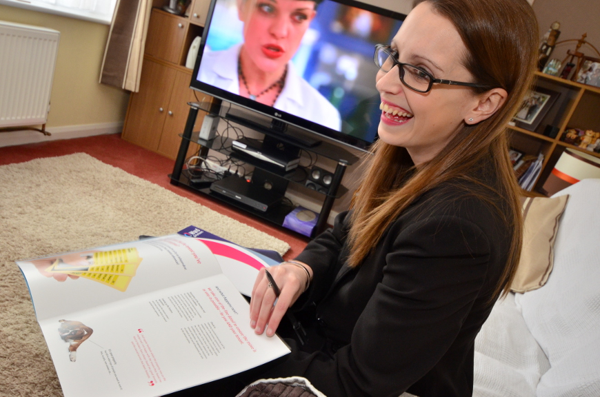 Laura discussing a brochure with clients