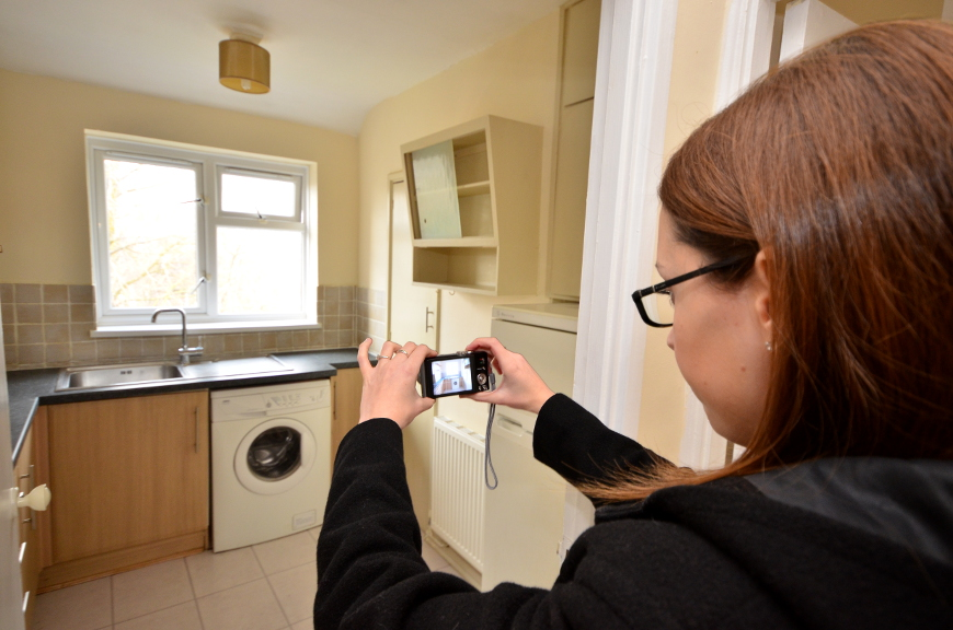 Taking a photo of a kitchen in a property