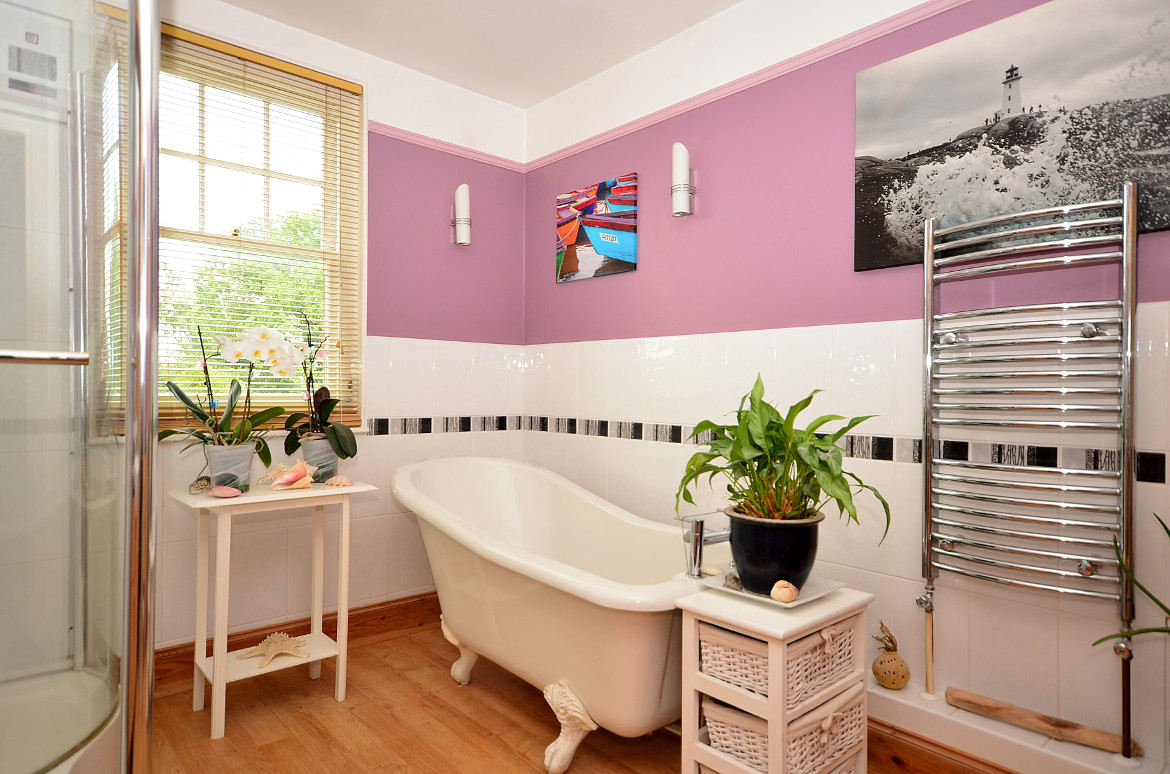 A bathroom that has been excellently decorated and enhanced by some plants